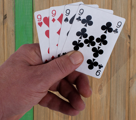 Poker game playing cards 4x 9 in the hand