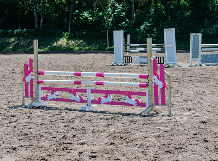 show jumping as a competitive sport with an obstacle Stock Photo - 102847847