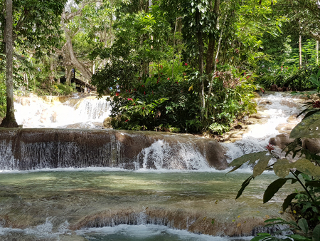Dunn River Falls are waterfalls in Ocho Rios, Jamaica Stock Photo - 105596469