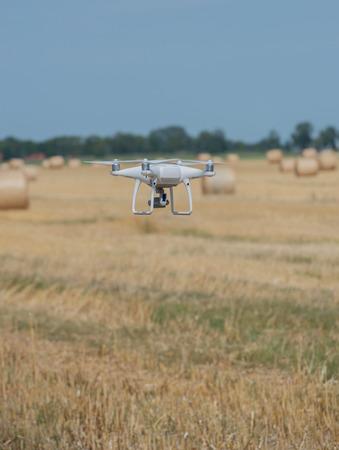Drone flight over a straw ball field