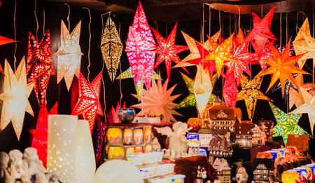 Christmas star lamp at a Christmas stall on a Christmas market Stock Photo