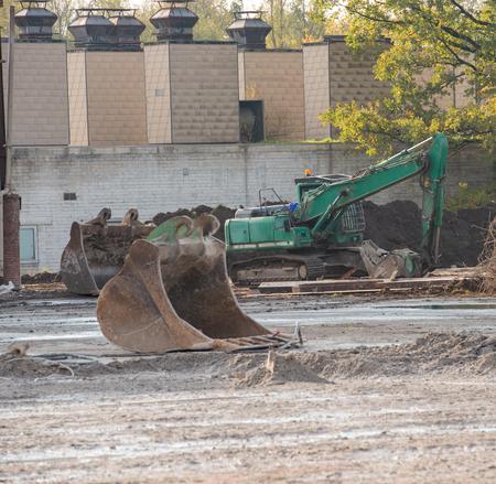 Building demolition with a demolition excavator at a building site
