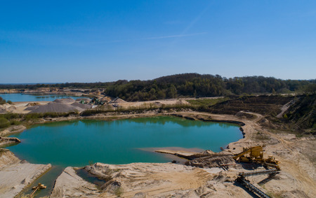Gravel quarrying in a gravel pit during a drone flight