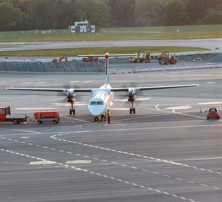 Airplane handling at a gate at Hamburg airport 写真素材