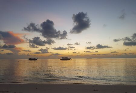 Sunset on the beach of the Maldives 写真素材