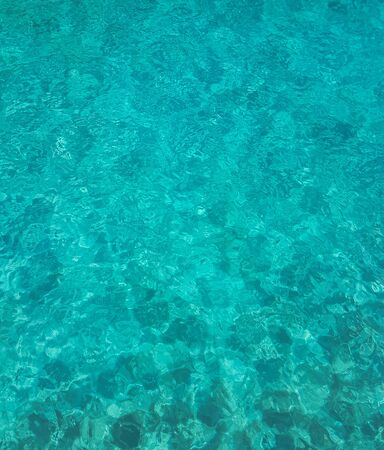 Turquoise waters on the Indian Ocean beach in the Maldives
