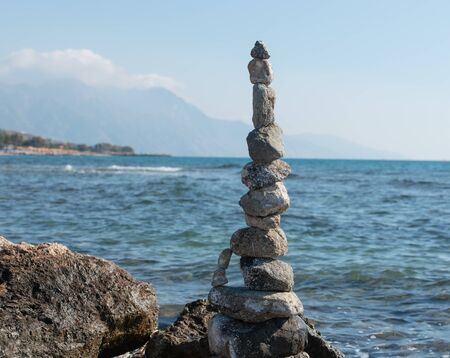 Stacked stones to the tower built on the beach of Kos Greece