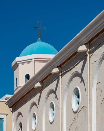 Blue white church in Kos city after an earthquake damaged Stock Photo