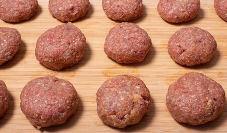 Minced meatballs prepared into round meatballs for cooking