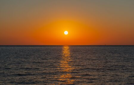 Sunset at 9pm from a yacht on the Mediterranean Sea off Kos Greece Stok Fotoğraf