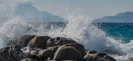 Waves at storm in Mediterranean Sea beating on breakwater on Kos Greece