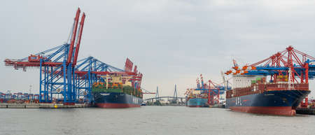 Container Terminal Eurogate Burchardkai in Hamburg, loading and unloading by the shipping company Container Ship APL, HMM and in the background the Köhlbrand Bridge Editorial