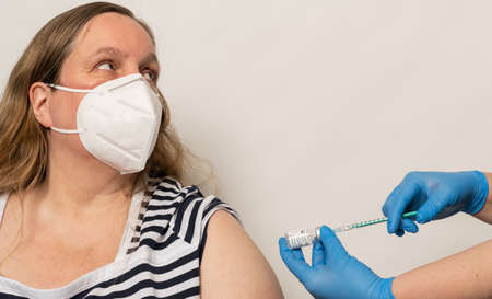 Woman is vaccinated with the vaccine COVID-19 mRNA