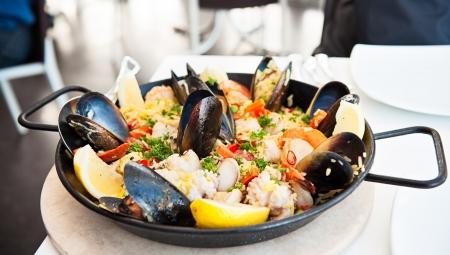Seafood paella pan on a restaurant table photo