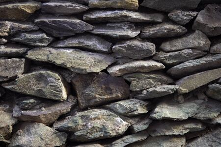 Old grey granite wall built of ancient stonework, abstract background with place for text. 写真素材
