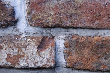 Close-up of old wall with ancient crumbling brickwork, you can see the structure of the bricks, abstract background with place for text. 写真素材