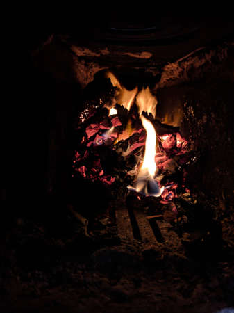 Paper burns and charred in the fireplace, bright red flame turns the pages of the book into dust. 写真素材
