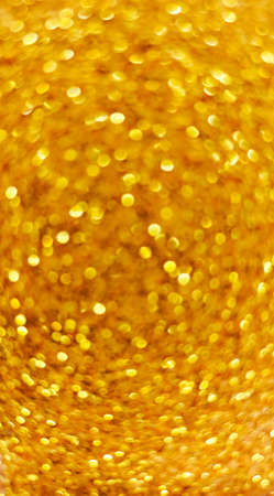 Yellow defocused abstract background,gold blurred round shaped bokeh
