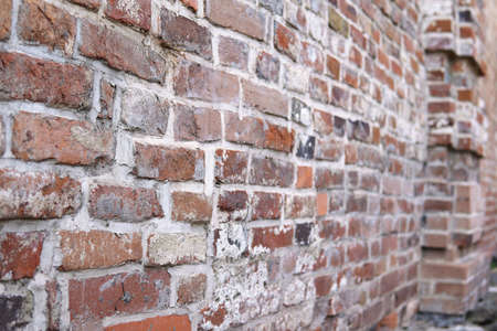 Ancient brick background,old wall with ancient brickwork, selective focus.