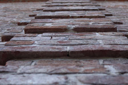 ledge at the brick old wall with ancient brickwork