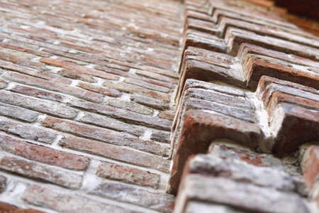 authentic brick wall of an old warehouse, selective focus.