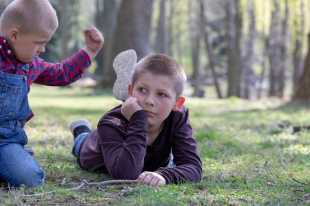 Two young brothers quarreling  in the Park
