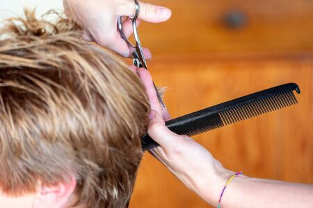 Female hair cutting scissors in a beauty salon