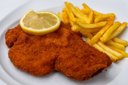 Breaded viennese schnitzel with french fries