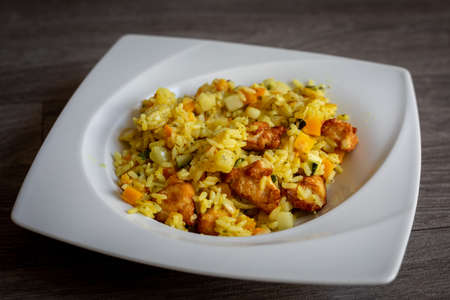 paella with meat, pepper, vegetables and spices on dish Reklamní fotografie