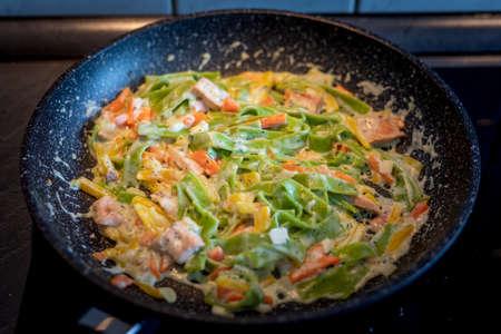 Close up Spinach Tagliatelle. Italian pasta with salmon in cream sauce and parmesan Banco de Imagens - 150646321