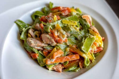 Salmon and Spinach Fettuccine pasta on white dish