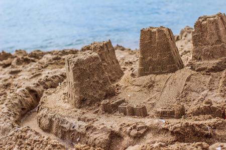 A sand castle on a sandy beach
