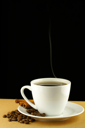 cheerfulness: Cup of coffee with beans and cinnamon
