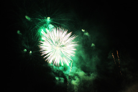 . Fireworks. Firework. A bouquet of bright green lights in the night sky during the holiday of the New Year and Christmas
