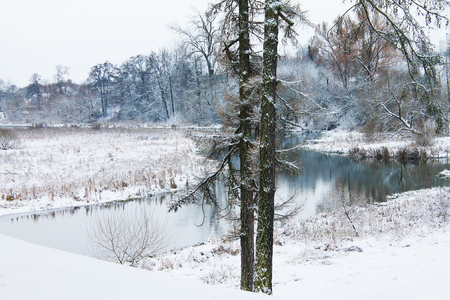 Winter. Christmas and New Year. Snowy bend of the village river. Winter landscape Stock Photo