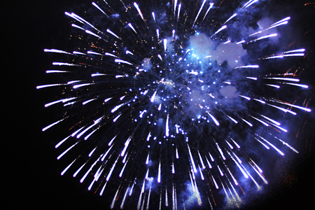 Inflorescence of bright blue firework lights. Halloween, Christmas, Independence Day, New Year.