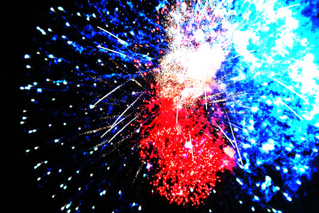Halloween, Christmas, Independence Day, New Year .. Inflorescence of bright blue, blue and red firework lights, similar to a dragon