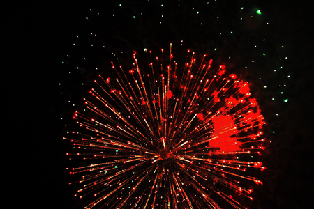 Halloween, Christmas, Independence Day, New Year .. Inflorescence of bright red firework lights., Similar to an aster flower