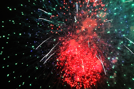 . Halloween, Christmas, Independence Day, New Year .. Inflorescence of bright green and red firework lights.