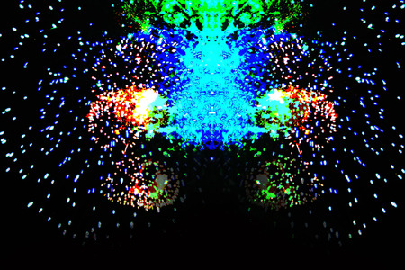 A flash in the form of a dash of bright green, blue and yellow firework lights. Halloween, Christmas, Independence Day, New Year. Zdjęcie Seryjne