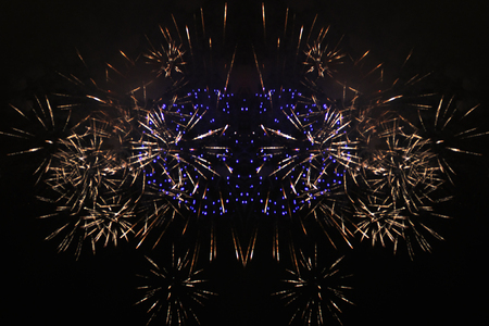 An outbreak of bright blue and yellow firework lights. Halloween, Christmas, Independence Day, New Year.