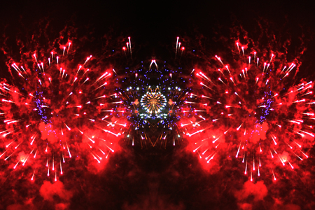 An outbreak of bright red and blue lights of fireworks. Halloween, Christmas, Independence Day, New Year.