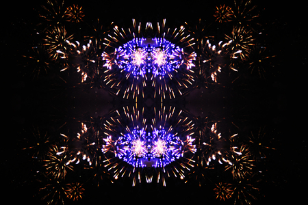 An outbreak of bright purple and yellow firework lights. Halloween, Christmas, Independence Day, New Year.