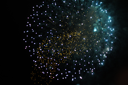 Flame of bright green and yellow firework lights. during Halloween, Christmas, Independence Day, New Year.