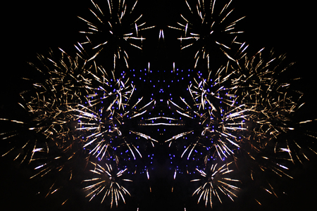 A fabulous view of bright white and blue fireworks. during Halloween, Christmas, Independence Day, New Year.