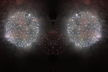 . Balls of bright white and pink firework lights. during Halloween, Christmas, Independence Day, New Year. Zdjęcie Seryjne
