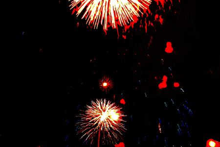A fabulous view of the bright red lights of fireworks during Halloween, Christmas, Independence Day, New Year.