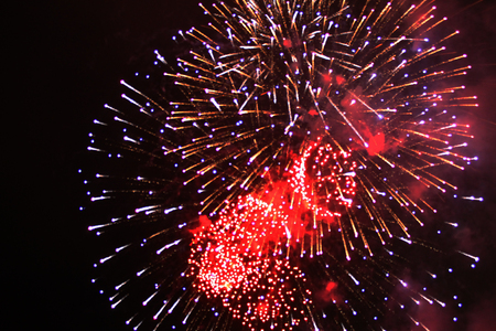 Fabulous shine of bright red and purple firework lights. during Halloween, Christmas, Independence Day, New Year.