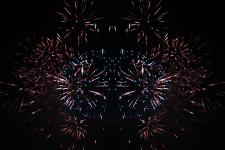 Star scattering of bright pink, blue and yellow firework lights during Halloween, Christmas, Independence Day, New Year.