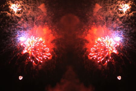 The firestorm of bright red firework lights during Halloween, Christmas, Independence Day, New Year.